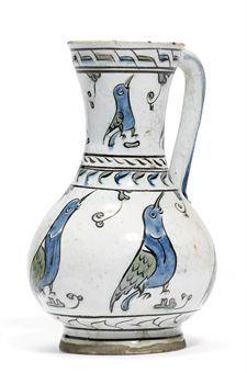 AN IZNIK POTTERY JUG OTTOMAN TURKEY, CIRCA 1650  about Iznik see article:  http://www.vam.ac.uk/content/journals/research-journal/issue-03/kutahya-ceramics-and-international-armenian-trade-networks/  #Armenian ceramists