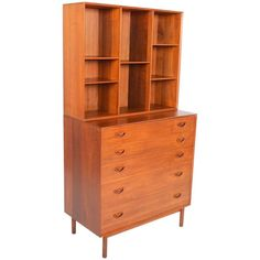 Peter Hvidt Modular Teak Dresser with Bookcase Hutch | From a unique collection of antique and modern dressers at https://www.1stdibs.com/furniture/storage-case-pieces/dressers/