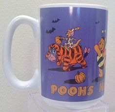 Pooh's Happy Halloween Disney Store Coffee Mug Eyeore Pooh Piglet Tigger The Disney Store Pooh's Happy Halloween Coffee Mug http://www.amazon.com/dp/B017MP8YO4/ref=cm_sw_r_pi_dp_jd7owb1H16JVX