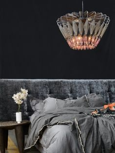 Our bespoke diamond chandelier drips with opulence. The strategically placed aluminium mesh panels and bent rods cast a harmonious blend of geometric shadows and light against the surrounding environment.  This decorative chandelier is an eye-catching lighting piece that serves as a focal point for the fifth wall in your home.