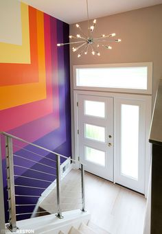 Gorgeous midcentury entry way, with striped mural and sputnik light  Photo by Charlotte Geary for ModernReston.com