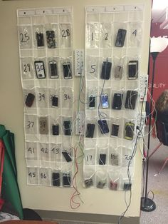 """Cell Phone Day Care"" a place for students to put their phones so they don't have them at their seats - but doubles as a charging station to encourage them to put them there.  Day 1 was successful - hopefully it will keep up and keep distractions out of the classroom!"