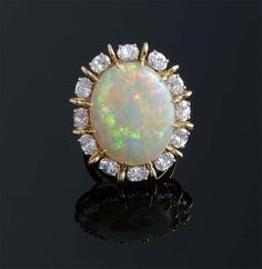 Oval Cabochon Opal and Diamond Ring Mounted In 18k Gold And Platinum ~ M.S. Rau Antiques