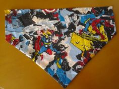 Marvel, over the collar bandana. 14 inches wide. 10 inches to the point. Pictures show both sides. £5 plus £1 postage
