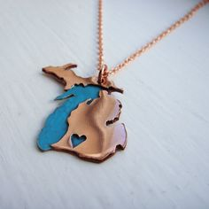 Copper Michigan necklace w/heart punched wherever you would want, like Marshall! My new fav, only $45. Love mine.