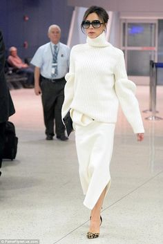 Victoria Beckham wearing Cutler and Gross 0811 Sunglasses, Victoria Beckham Puff Longsleeved Chunky Sweater and Victoria Beckham Twist Drape Wool Felt Kick Midi Skirt