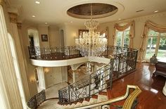 Double Staircase Foyer   ... black brass staircase and peer into the foyer below from the gallery