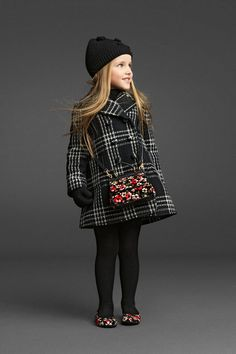 If she has to be caught in outerwear that was not Burberry, she could settle on Dolce & Gabbana.