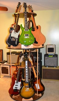 Interesting idea for a guitar room ... View product details at: http://www.guitarstorage.com/shop/multi-guitar-stands