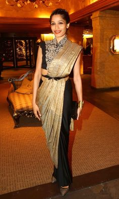 Frieda Pinto worked a gold and black gown with a cinched in waist.