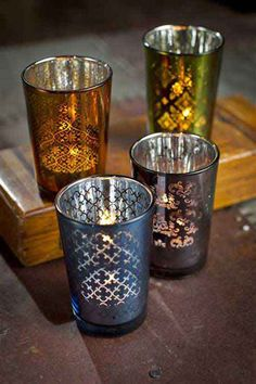 Set the table in style with these gorgeous retro votive holders. Four colorful jewel-toned and playfully etched glasses make up this set of vintage-feeling Moroccan candle holders. Traditional Morocca
