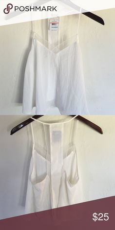 Free People Silky Tank XS NWT Sweet silky soft fabric tank. Delicate straps with slight mesh accents. Brand new with tags. Free People Tops Camisoles