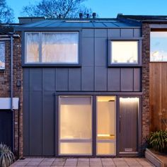 Day House by Paul Archer Design is a zinc-clad home slotted into an existing London terrace