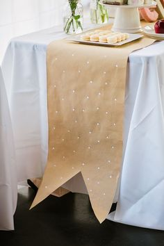 Kraft Paper Craft with white polka for runner / http://www.deerpearlflowers.com/rustic-country-kraft-paper-wedding-ideas/2/
