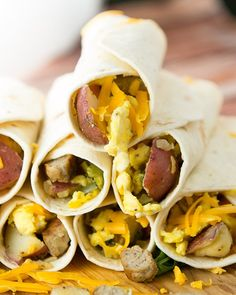 Simple Breakfast Burritos loaded with eggs, sausage, potatoes and cheese. Perfect for busy mornings. They freeze great too! Healthy Breakfast Options, Savory Breakfast, Breakfast Burritos, Breakfast Dishes, Breakfast Recipes, Vegetarian Breakfast, Healthy Breakfasts, Sausage Breakfast, Breakfast Casserole