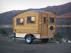 A small trailer-mounted wooden camper built by Casual Turtle Campers.