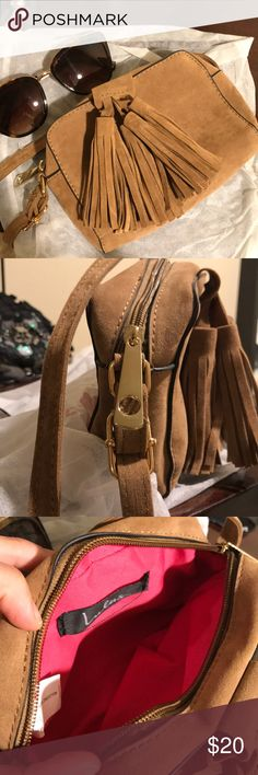 Lulus small tassel crossbody NWOT. Suede like material. Small no pockets inside, hot pink color inside as well. Never used. Dust bag comes with. I'm about 5'9 and it sits right on my hip. 5x6x2 Bags Crossbody Bags