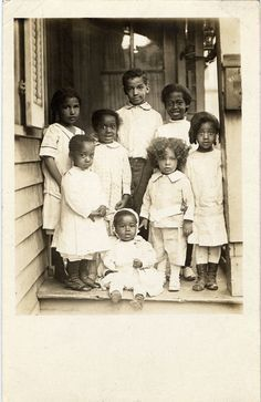 """detroitlib: """" Postcard of eight unidentified African American children posing on the porch. Stamped on back: """"Harvey C. Jackson photographer 474 Beaubien St., Detroit."""" • Courtesy of the Burton Historical Collection, Detroit Public Library """" #VintageKidsFashion Vintage Pictures, Old Pictures, Old Photos, Antique Photos, American Children, American Women, American Art, American Photo, Black History Facts"""