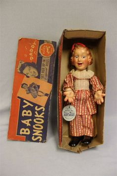 """12""""  Baby Snooks celebrity doll, features composition head and hands, wooden painted torso and feet, and durable woven mesh wire arms and legs for posing, from the Flexy Doll line of toys, based on the character played by Jewish radio star Fanny Brice, United States, 1938, Ideal Toy Corp."""