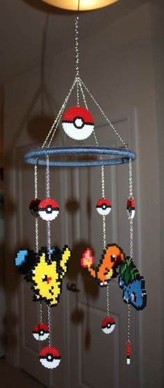 Pokemon Perler Bead Mobile. My kids are going to hate me when they grow up and realize I geeked out everything they ever owned from day one. Oh well :D!