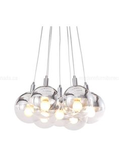 Half chrome, half glass, the Time ceiling lamp is the perfect blend of the two. The lamp comes with seven 40W bulbs.