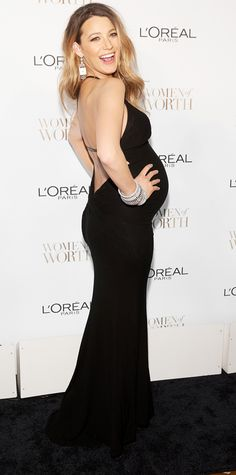 blake lively   stunned in a sexy black backless gown that showed off her growing belly, paired with diamond earrings and bangles for the L'Oreal Women of Worth Event in New York City.