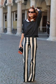 Taylor Tomasi Hill - Street style star and former fashion editor Taylor Tomasi Hill kept things simple and sophisticated, pairing a loose gray sweater and a white collared shirt with her bold, striped pants. Taylor Tomasi, Looks Style, Street Style Looks, My Style, Look Fashion, Womens Fashion, Fashion Tips, Fashion Trends, Milan Fashion