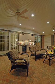 Vertical shot of granite countertop area and ceiling fan.