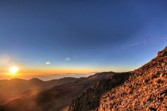 """Is the view worth driving 1.5 hours in the wee hours of the morning, just to catch the sunrise at the summit of Haleakalā (Maui)? The East Maui volcano was not named Haleakalā aka""""House of the Sun"""" for no reason!See for yourself. You be the judge…"""