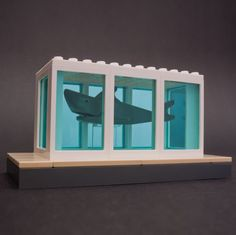 A mini replica of one of Damien Hirst's most famous pieces, his shark sculpture. 6.5 x 13.5 x 6.5 cm. Please allow 3-4 weeks for shipping.