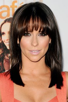 Jennifer Love Hewitt. Medium length hair with bangs. Makeup is simple but dramatic