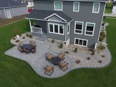 This landscaping project really adds to the appeal of this backyard. It looks like it was built with the house! The similar colors of the patio pavers and the exterior of this house is not something you get with every landscape. It really makes this patio jump out of the space. The combination of #LandscapingPavers