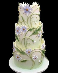 3 tier wedding cake eith intricate lilac floral design