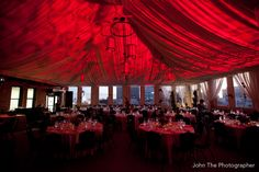 An overview of the reception area with red up-lighting at The Citizen Hotel, Metro Terrace.