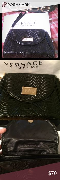 Black versace clutch or evening bag/wristlet Authentic black clutch Versace. Brand new with dustbag. Very classy with swirl pattern. Perfect for evening purse or night out. Versace Bags Clutches & Wristlets