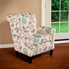 Give your living room the perfect spot to lounge and relax with this beautiful club chair. A blue and beige floral upholstery provides the room with some attractive color, while the generous padding i