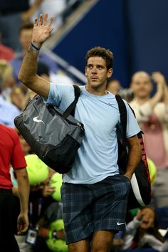 Juan Martin Del Potro Photos Photos - Juan Martin Del Potro of Argentina waves to the crowd after losing to Lleyton Hewitt of Australia during their match on Day Five of the 2013 US Open at USTA Billie Jean King National Tennis Center on August 30, 2013 in the Flushing neighborhood of the Queens borough of New York City. - US Open: Day 5