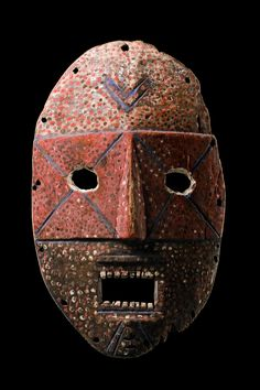 """masks of the Kumu are called """"nsembu"""" or """"ibole""""; they appear in paired dances that contrast male and female roles during initiation into the """"nkunda"""" divination society. H: 34 cm H: 13.4 inch Provenance Jean Gürr, Geneva, Switzerland Eduard Hess, Basel, Switzerland"""