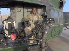 Another CH-146 proud door gunner keeping the ship protected with some massive fire-power!