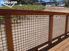Grid fencing in between wood framing makes for an open view but quick railing for a deck.  You can pre-build the sections on a bench or table.