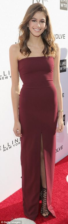 Wow: Kaia, 15 - the mirror image of her model mom - looked gorgeous in a floor-length strapless maroon dress