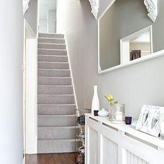 Grey traditional hallway with laminate flooring