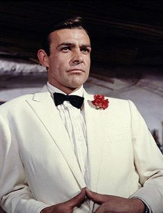 Sean Connery in Goldfinger-How can you beat a man in a white smoking jacket? The epitome of class...
