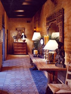 The Mediterranean-inspired look of this space comes together with rustic, wooden furnishings, hexagonal floor tiles and faux-painted adobe w...