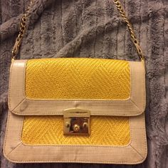Rebecca Minkoff Straw Bag With Gold Hardware Rebecca Minkoff yellow straw handbag with light gray accents and gold hardware. The bag has a zipper pocket inside and two little pockets as well. There is a pocket on the back of purse. The length is 10 inches, width is 1 and 1/2 inch, and height is 8 inches. The drop is 9 inches from strap to bag it can be detached.. There are two dark marks on left side I tried to show in pictures!! Thanks Rebecca Minkoff Bags Clutches & Wristlets
