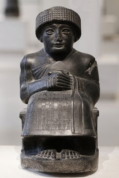 Seating diorite statue of Gudea,  prince of Lagash, dedicated to the god Ningishzida, c. 2120 BC (neo-Sumerian  period). Excavated in Telloh (ancient Girsu), Iraq.