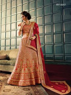 Buy Designer Bridal Lehengas, Wedding Lehengas Online : Classy and elegant red raw silk unstitched lehenga choli decorated with zari work and stone detailing. Paired with a matching dupatta. It can be customized upto size 42. *Call / Whatsapp / Viber : +91-9052526627 *Email : customercare@natashacouture.com *Worldwide Shipping | Free shipping in India | Cash on delivery *