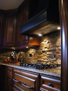 Stone Backsplash. Love! And with the dark cabinets?! Perfection!