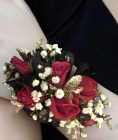 Red Rose Wrsitlet-Prom wristlet of red roses with black and gold trim and baby's breath.