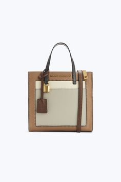 Meet the easy, classic mini bag made for going where you go. Shop Marc Jacobs The Colorblock Mini Grind Bag. Cow Leather, Pebbled Leather, Interior Logo, Large Wallet, Marc Jacobs Bag, Hermes Kelly, Handbag Accessories, Mini Bag, Continental Wallet
